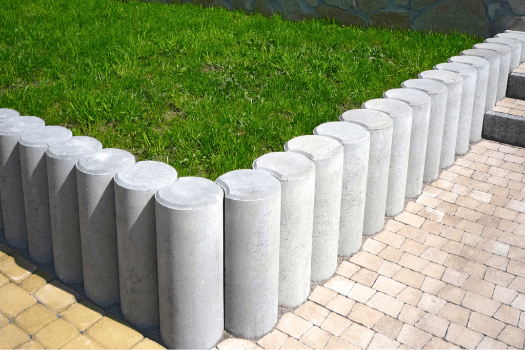 lawn with pillars and pavers