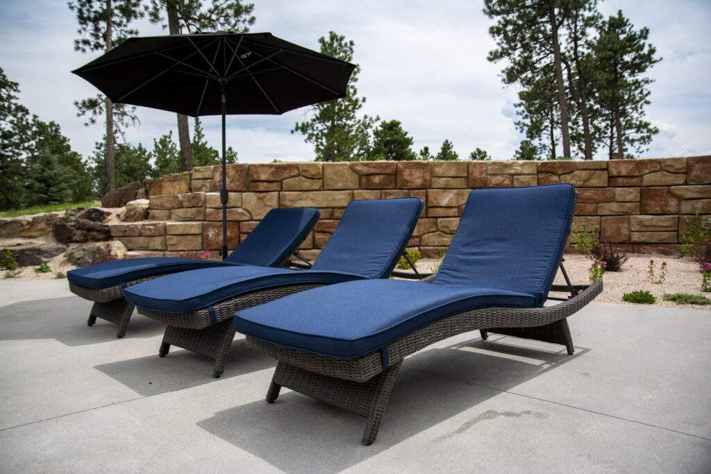 Lounge chairs in front of retaining wall